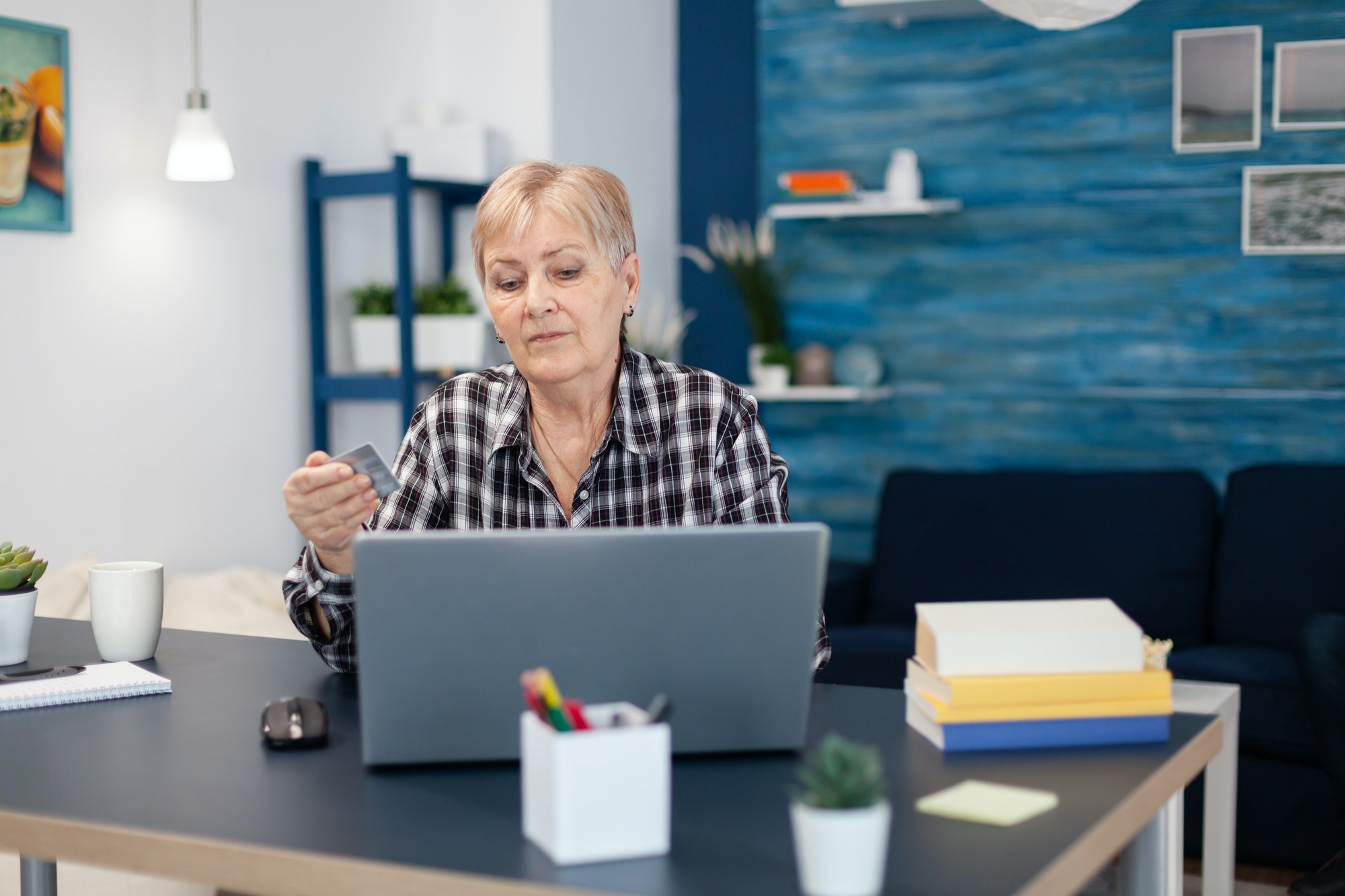 Senior woman learning to do bank operation